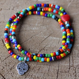 Sugar skull charm stretch bracelet with large multicolored beads