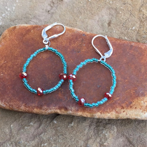 Flexible hoop earrings with Turquoise seed beads and orange crystals