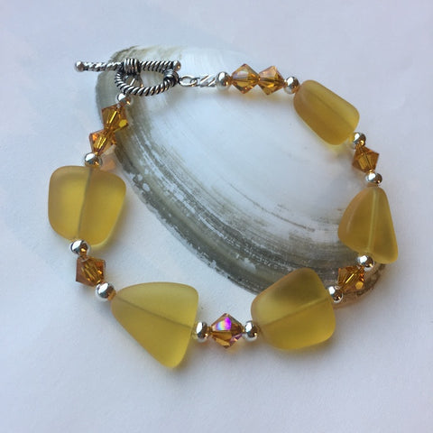Amber-colored sea glass bracelet with Swarovski crystals and sterling silver