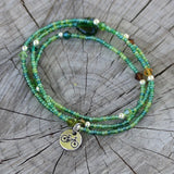 Bike charm stretch necklace or triple wrap bracelet with green seed beads and Swarovski crystal accents