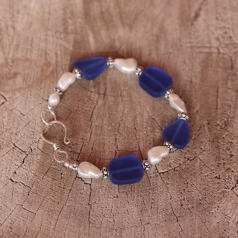 Blue recycled sea glass bracelet with freshwater pearls and sterling silver
