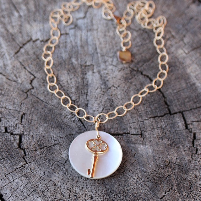 Bronze key and shell pendant necklace on 14k gold filled chain