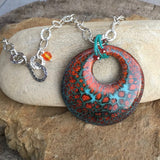 Turquoise and orange enamel shield pendant on hammered sterling chain