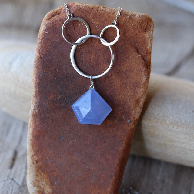 Faceted blue chalcedony pendant on sterling silver chain with rings