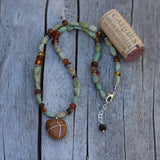 Durango trails stone pendant necklace with green turquoise and Baltic amber and cork for size reference