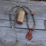 Durango Trails Collection red stone pendant necklace with agate and carnelian. Cork for size reference