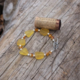 Recycled amber-hued sea glass bracelet with Swarovski crystals