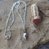 Elegant baroque pearl pendant necklace with gray Swarovski crystal on sterling chain. Cork for size reference.