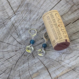 Bike charm earrings with cork for size reference