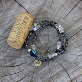 Bike charm stretch necklace or triple wrap bracelet with gray and purple beads and clear crystal accents.  Cork for size reference