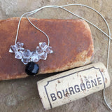 Onyx pendant necklace with clear crystals on sterling chain with cork for size reference