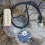 Black silk agate stone pendant necklace with sterling Om charm on twisted rubber cord with cork for size reference