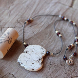 Calcite stone pendant necklace on hand knotted cord with crystals and silver plated brass beads with cork for size reference