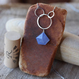 Faceted blue chalcedony pendant necklace with sterling interlocking rings on sterling chain