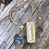 Gold rimmed druzy stone pendant necklace with brass flower and branches on gold filled chain with cork for size reference