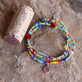 Stretch necklace or triple wrap bracelet with sterling equality charm and rainbow bead mix.  Cork for size reference.