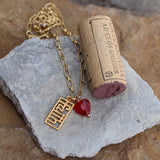 14k gold filled faith pendant with red glass heart on 14k gold filled chain. Cork included for size reference