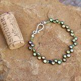 Fun green bubble pearls bracelet with Swarovski crystals and sterling clasp, cork for size reference