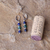 Sterling silver lever back earrings with blue lapis, sterling silver and green Swarovski crystals. Cork for size reference