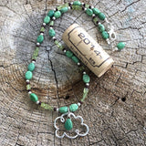 """Pray for rain"" cloud pendant necklace with faceted turquoise drop and peridot. Cork for size reference"