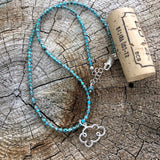 """Pray for rain"" cloud pendant necklace with turquoise heshi beads and cork for size reference"