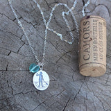 Sterling chain necklace with sterling pendant etched with a stand-up-paddleboard girl with a glass heart dangle.  Cork for size reference