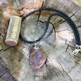 Stone pendant necklace with sterling compass charm on rubber cord
