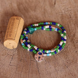 Green and blue beaded stretch necklace or triple wrap bracelet with pewter heart lock charm and cork for size reference