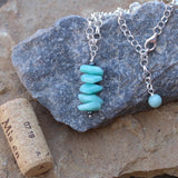Aqua blue amazonite stack pendant necklace on sterling silver chain. Cork for size reference.
