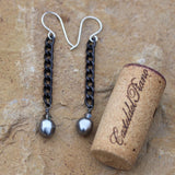 Black chain earrings with gray Swarovski pearls and crystals and sterling silver French ear wires. Cork shown for size reference.