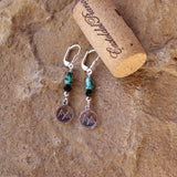 Sterling silver mountains charms earrings with turquoise and black Swarovski crystals. Cork shown for size reference.