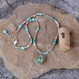 Turquoise nugget stone pendant necklace with Thai sterling silver beads and hexagonal turquoise beads. Cork for size reference.
