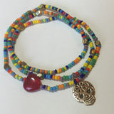 Multicolored seed bead stretch necklace or triple wrap bracelet with bronze sugar skull charm