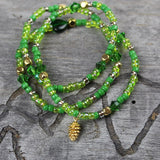 Green beaded stretch necklace or triple wrap bracelet with golden pine cone charm