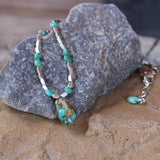 Close up of turquoise nugget pendant necklace with Thai sterling silver beads and turquoise hexagon beads.