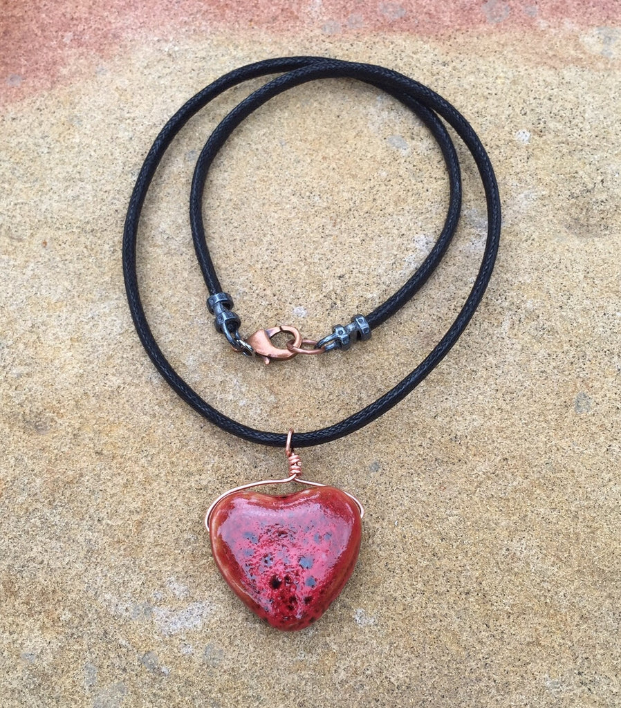 Red ceramic heart necklace on cord with copper wire