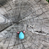 Faceted amazonite drop pendant on delicate sterling silver chain with hematite and rhodochrosite accent beads.