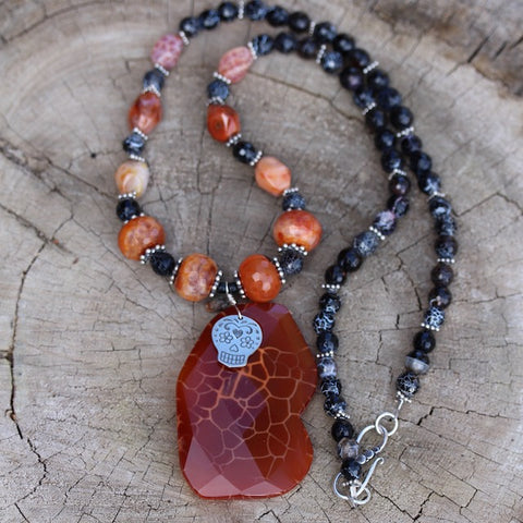 Red agate stone pendant necklace with a sugar skull charm