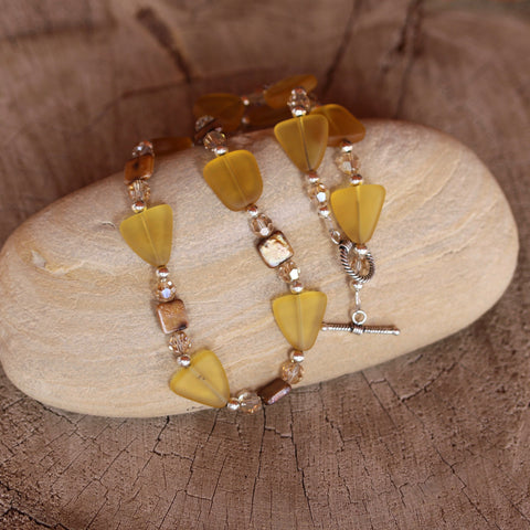 Amber-colored recycled sea glass necklace with freshwater pearls and Swarovski crystals