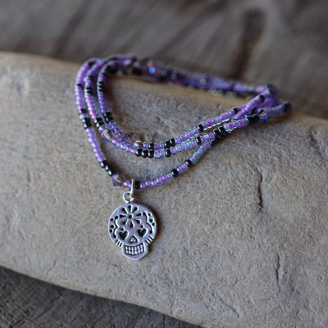 Stretch necklace or bracelet with silver plated sugar skull charm and purple seed beads