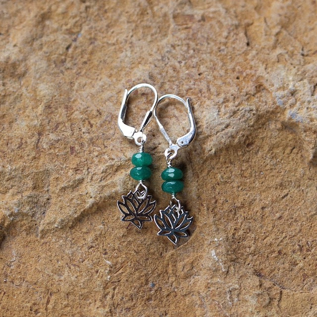 Sterling earrings with a tiny lotus charm and 2 faceted green emerald beads. Sterling silver lever back ear wires for security.