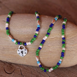 Stretch necklace or triple wrap bracelet with green, blue and white beads and a heart shaped lock charm