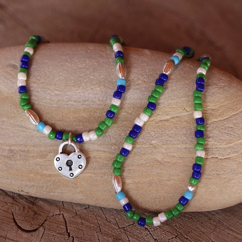 Green and blue beaded stretch necklace or triple wrap bracelet with pewter heart lock charm