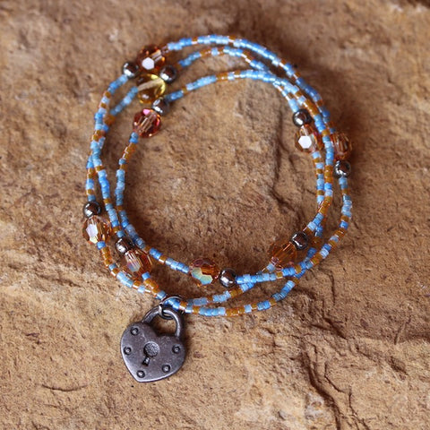 Stretch necklace or triple wrap bracelet with blue seed beads and gunmetal locket charm