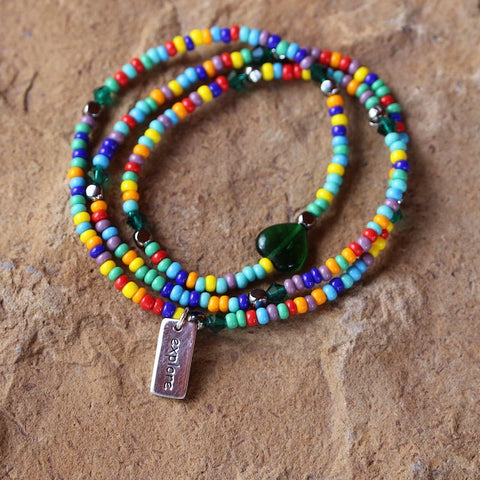 Colorful stretch necklace or triple wrap bracelet with sterling silver explore charm