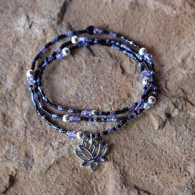 Stretch necklace or triple wrap bracelet with purple seed beads and silver lotus charm
