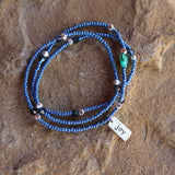 Stretch necklace or triple wrap bracelet with blue seed beads and a sterling silver joy charm