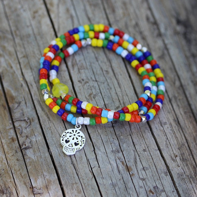 Multicolored stretch necklace or triple wrap bracelet with sugar skull charm
