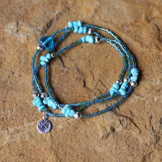 stretch triple wrap bracelet with turquoise and compass charm