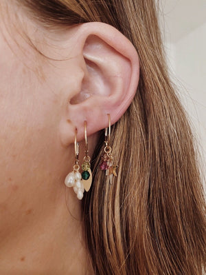 pearl cluster earrings on yellow gold hoops finerrings layered on ear